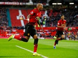 Manchester United's Ashley Young celebrates after opening the scoring against Fulham on December 8, 2018