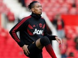 Chris Smalling warms up for Manchester United on November 24, 2018