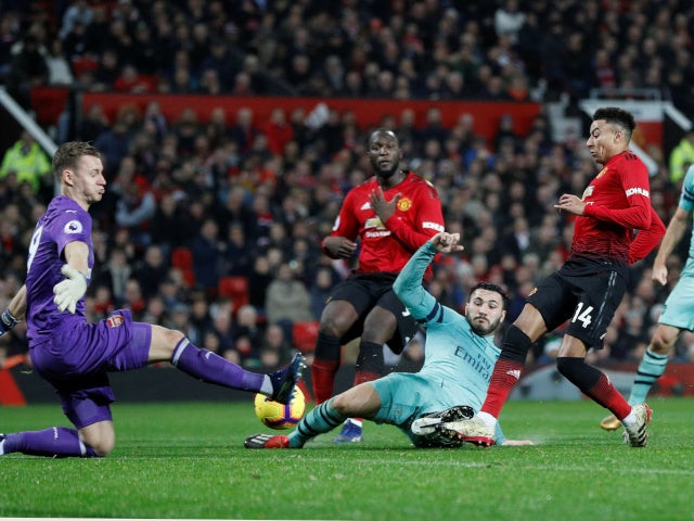 Manchester United's Jesse Lingard scores against Arsenal in the Premier League on December 5, 2018.