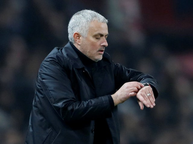 Manchester United manager Jose Mourinho checks his watch on December 5, 2018