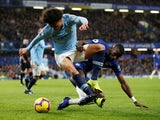 Leroy Sane and Antonio Rudiger in action during the Premier League game between Chelsea and Manchester City on December 8, 2018