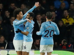 Leroy Sane celebrates scoring the opener during the Premier League game between Manchester City and Watford on December 4, 2018