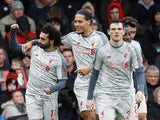 Mohamed Salah celebrates with teammates after scoring against Bournemouth on December 8, 2018