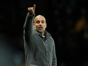 Pep Guardiola gives orders during the Premier League game between Manchester City and Watford on December 4, 2018
