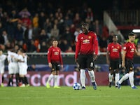 Manchester United's players react to falling behind against Valencia in their Champions League tie on December 12, 2018