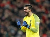 Alisson celebrates during the Premier League game between Liverpool and Manchester United on December 16, 2018