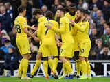 A group of Chelsea players celebrate the second goal during their game at Brighton on December 16, 2018