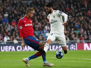 Real Madrid's Isco in action with CSKA Moscow's Rodrigo Becao on December 12, 2018.