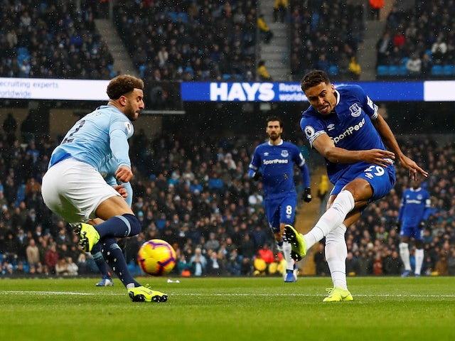 Dominic Calvert-Lewin shoots past Kyle Walker during the Premier League game between Manchester City and Everton on December 15, 2018