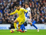 Eden Hazard and Dale Stephens in action during the Premier League game between Brighton & Hove Albion and Chelsea on December 16, 2018