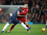 Eric Bailly and Roberto Firmino in action during the Premier League game between Liverpool and Manchester United on December 16, 2018