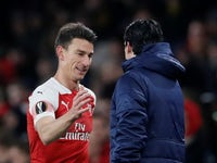Unai Emery greets Laurent Koscielny on the sidelines during Arsenal's Europa League tie with Qarabag FK on December 13, 2018