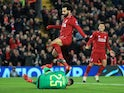 Liverpool's Mohamed Salah attempts to win the ball ahead of Napoli's David Ospina on December 11, 2018