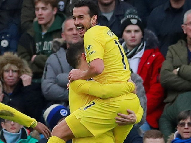 Pedro embraces Eden Hazard after scoring during the Premier League game between Brighton & Hove Albion and Chelsea on December 16, 2018