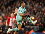 Pierre-Emerick Aubameyang and Maya Yoshida in action during the Premier League game between Southampton and Arsenal on December 16, 2018