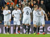 Michy Batshuayi and his teammates celebrate Valencia's second goal against Manchester United in their Champions League tie on December 12, 2018