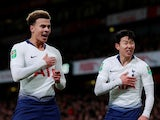 Tottenham Hotspur duo Dele Alli and Son Heung-min celebrate their goal against Arsenal on December 19, 2018