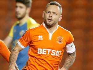 Spearing saves Blackpool blushes to set up Arsenal tie
