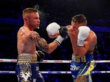 Josh Warrington and Carl Frampton in action on December 22, 2018