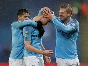 Man City survive penalties to make semi-finals