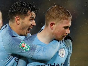 A nonchalant Kevin De Bruyne is embraced from behind during the EFL Cup quarter-final game between Leicester City and Manchester City on December 18, 2018