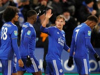 Leicester City winger Marc Albrighton celebrates with teammates after scoring in his side's EFL Cup quarter-final with Manchester City on December 18, 2018
