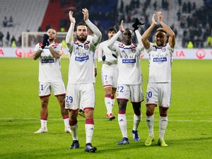 Lyon players applaud after they beat Monaco on December 16, 2018