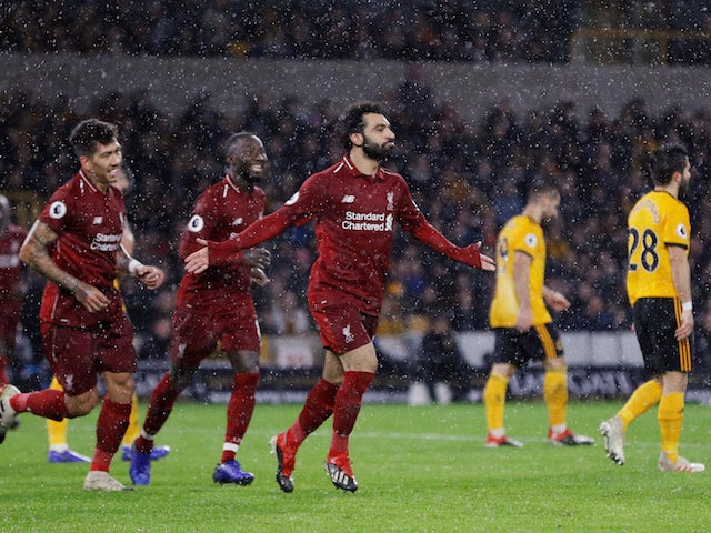 Liverpool striker Mohamed Salah celebrates after scoring the opening goal against Wolverhampton Wanderers on December 21, 2018