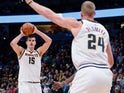 Nikola Jokic passes to Denver Nuggets teammate Mason Plumlee on December 16, 2018