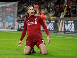 Liverpool defender Virgil van Dijk celebrates scoring against Wolverhampton Wanderers on December 21, 2018