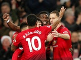 Paul Pogba is mobbed by his teammates after scoring Manchester United's second against Huddersfield Town on December 26, 2018