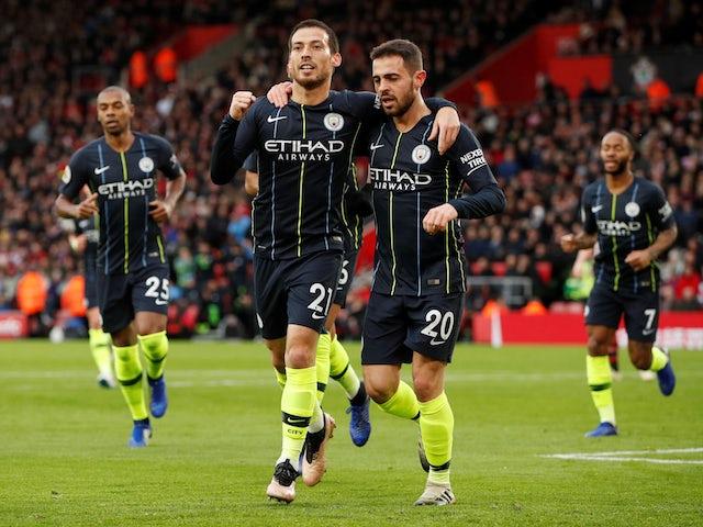 Manchester City midfielder David Silva celebrates with namesake Bernardo Silva after scoring against Southampton on December 30, 2018