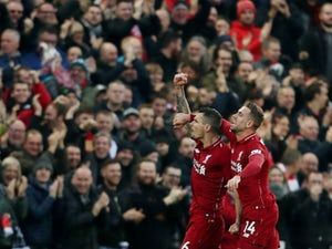 Liverpool march on to move six points clear