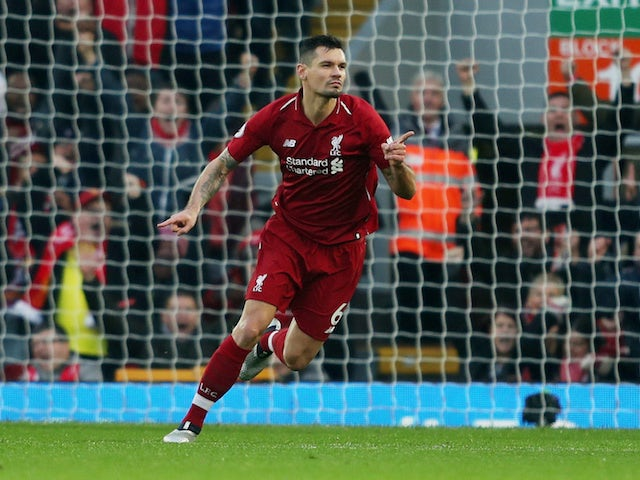 Liverpool defender Dejan Lovren celebrates scoring against Newcastle United on December 26, 2018