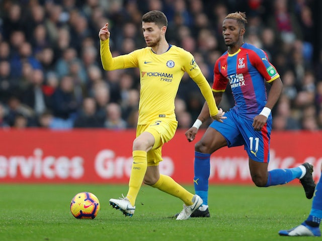 Jorginho and Wilfried Zaha in action during the Premier League match between Crystal Palace and Chelsea at Selhurst Park.