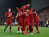Liverpool players celebrate scoring against Arsenal on December 29, 2018