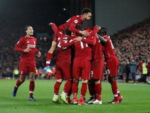 Five-star Liverpool thrash Arsenal to move nine clear