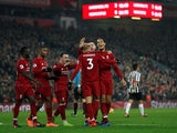 Liverpool players celebrate after Fabinho's goal during their win over Newcastle United on December 26, 2018
