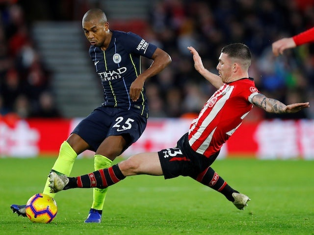 Southampton's Pierre-Emile Hojbjerg dives into a challenge on Manchester City midfielder Fernandinho which earns him a red card on December 30, 2018