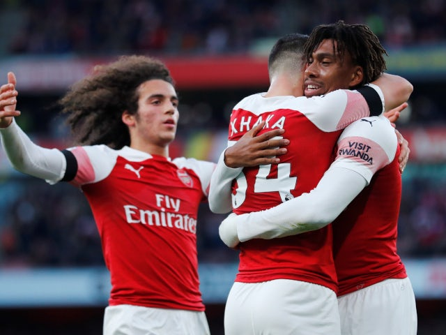 Granit Xhaka celebrates with his teammates after putting Arsenal in front against Fulham in their Premier League clash on January 1, 2019