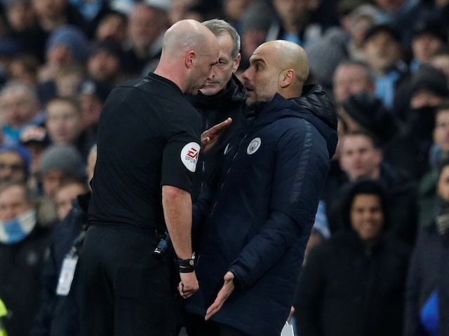 Anthony Taylor has words with Pep Guardiola during the Premier League game between Manchester City and Liverpool on January 3, 2019