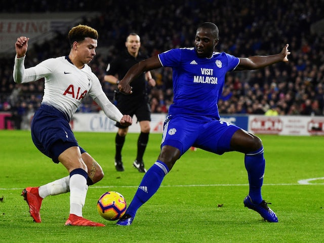 Tottenham Hotspur's Dele Alli in action with Cardiff City's Sol Bamba on January 1, 2019.