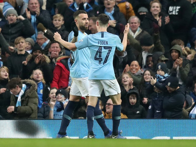 Nicolas Otamendi celebrates with Phil Foden after scoring the sixth during the FA Cup third-round game between Manchester City and Rotherham United on January 6, 2019