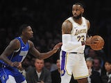 Los Angeles Lakers forward LeBron James (23) controls the ball against Dallas Mavericks forward Dorian Finney-Smith (10) during the first half at Staples Center on December 30, 2019.