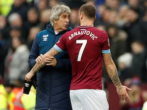 Marko Arnautovic looks unhappy to be subbed off by West Ham manager Manuel Pellegrini on January 5, 2019
