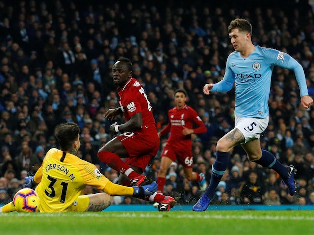 Liverpool striker Sadio Mane fires past Ederson but off the post during their Premier League clash with Manchester City on January 3, 2019