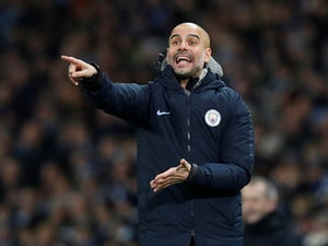 Pep Guardiola gives orders during the Premier League game between Manchester City and Liverpool on January 3, 2019