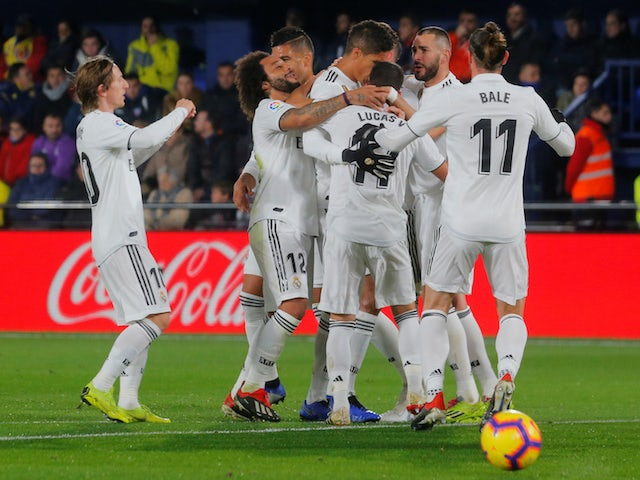 Real Madrid players celebrate scoring their second goal against Villarreal on January 3, 2019.