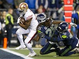 San Francisco 49ers running back Raheem Mostert (31) rushes for a touchdown against Seattle Seahawks cornerback Shaquill Griffin (26) and defensive back Lano Hill (42) during the fourth quarter at CenturyLink Field on December 30, 2019