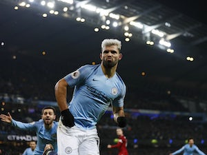 Sergio Aguero celebrates scoring the opener during the Premier League game between Manchester City and Liverpool on January 3, 2019